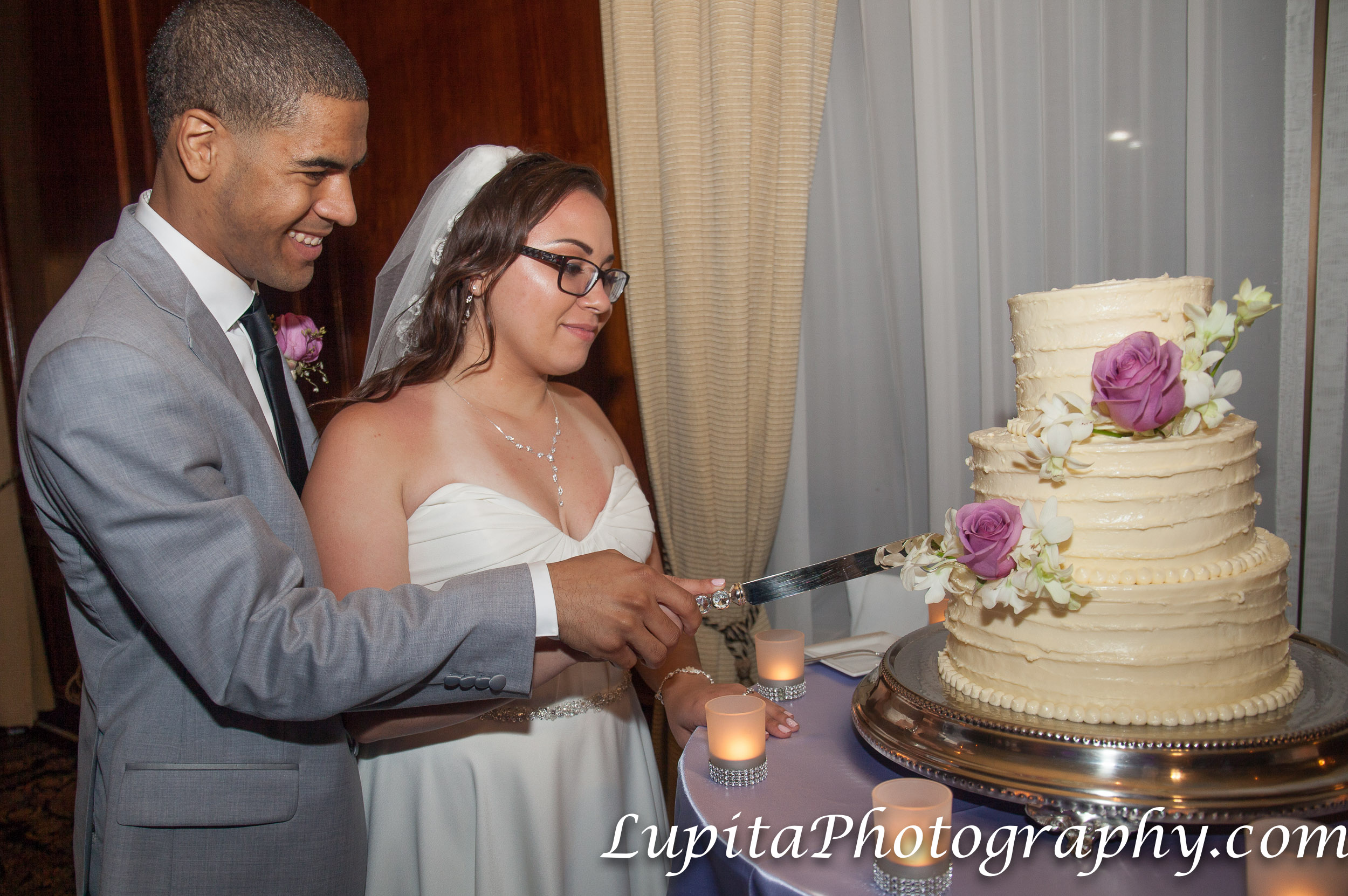 Meliá Coco Beach Resort. Rio Grande. Puerto Rico.  Couple cutting the delicious cake!