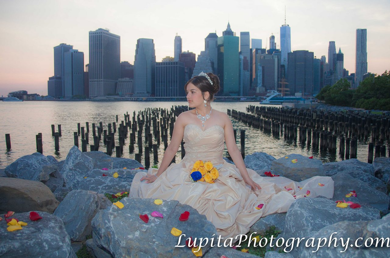 Quinceañera celebrating her birthday. Brooklyn Bridge Park. New York City.